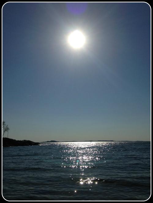 act-prep-solar-eclipse-glasses-sun-pic-over-ocean